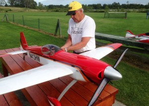 Jerry Galbreath of Marion readies his plane for flight.