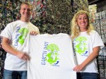 Nick (left) and Chelsea Sims Van Meter show off the Free T-shirts being given away at all Sims Brothers Recycling locations.