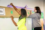 Marion Harding High School students paint the teen room at the Boys and Girls Club of Marion County