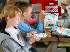 Kids dig into their lunch at the Boys & Girls Club during the 2013 Summer Lunch Program.