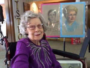 June at 102 years old with 2 of her paintings.