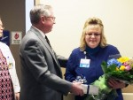 Bruce Hagen, OhioHealth Marion General Hospital President, presents Chris Myers, RN, nurse manager 2 South inpatient unit, with her 2015 Manager of the Year honors.