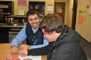 Marion Harding High School Assistant Principal Ryan Rismiller talks to student Ryan Sayre at Harding. The Ohio Association of Secondary School Administrators has named Rismiller as its 2017 Assistant Principal of the Year.