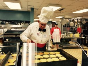 Kiwanis member Jack Bull working the pancake grill.
