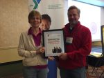 YMCA Executive Director, Theresa Lubke, accepted the award from the Ohio Alliance of YMCA's board chair, Brad Toft, at the Alliance's annual Chief Executive Conference earlier in October.